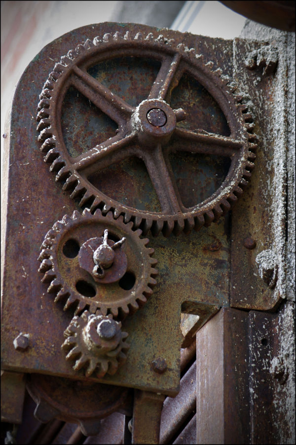 The gears of a metal garage door