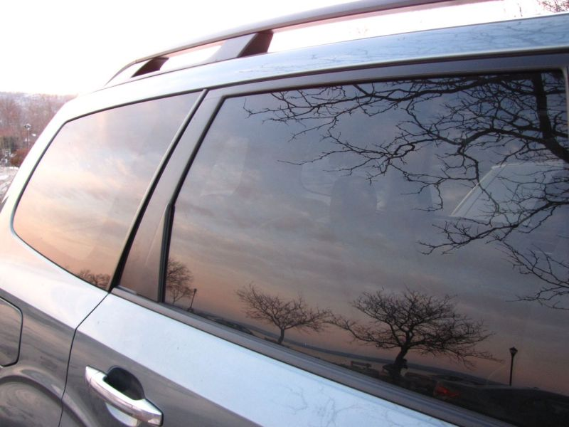 The sky reflected in a car window