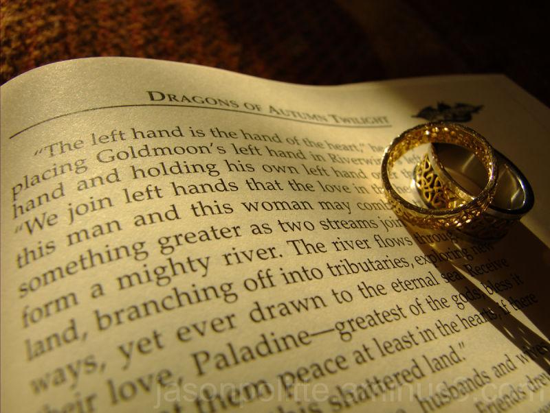 "Wedding Rings atop ""Dragons of Autumn Twilight"""