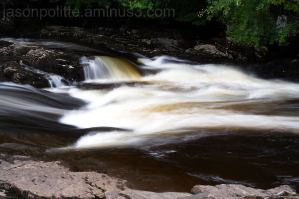 The fast moving Falls of Dochart flow