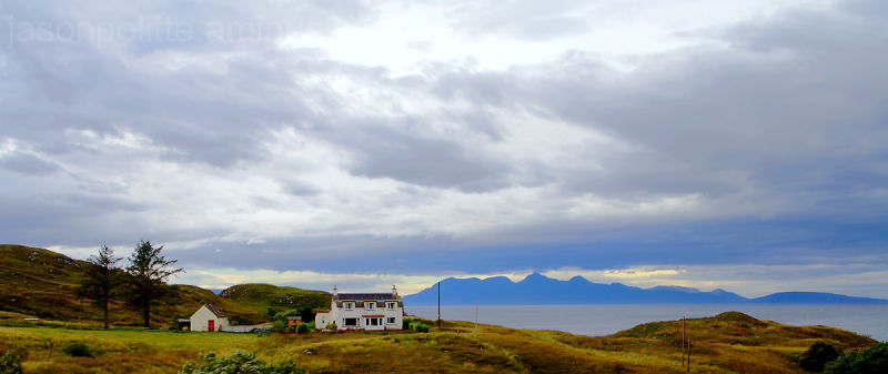 A house on the Scottish coast with the Isle of Rum