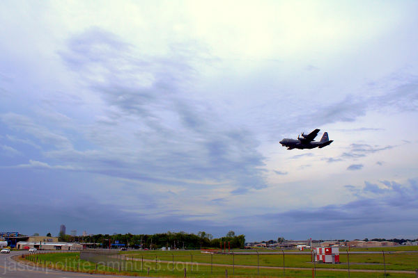 C-130 Hercules performs a touch-and-go.