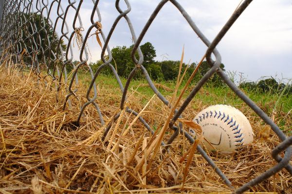 Lone softball at a rundown ball field