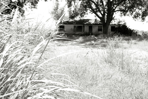 High key shot of vacant house and lot
