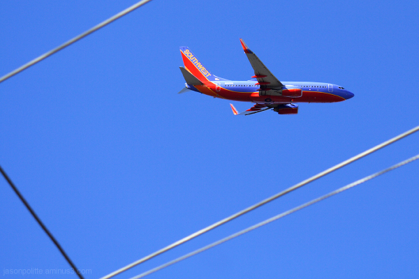 Southwest 737 framed by powerlines