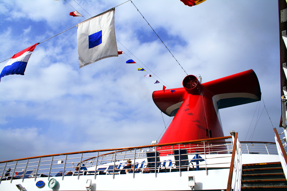 The Carnival Elation's Whale Tail with flags.
