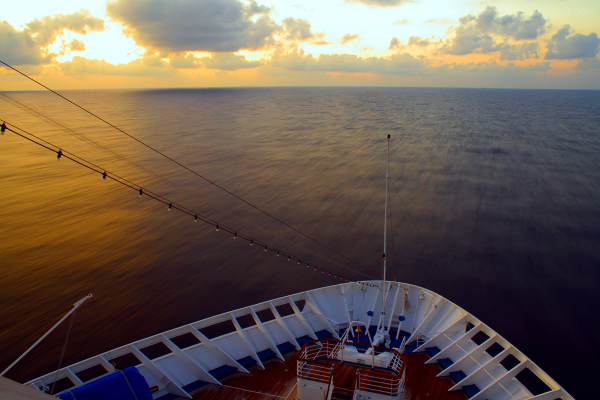 The Carnival Elation's bow during sunrise.