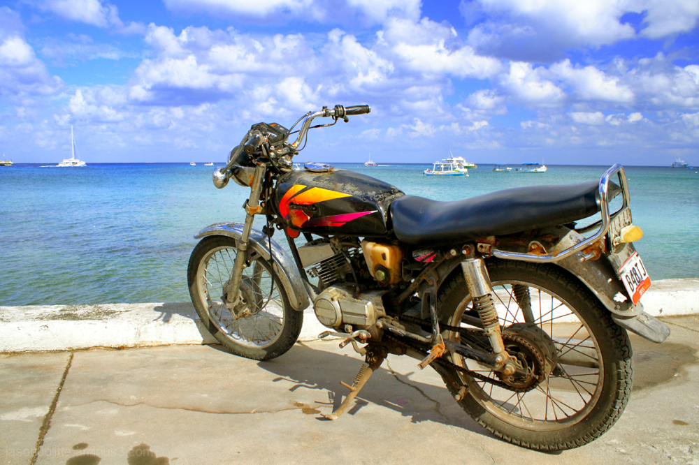 Rusty motorcycle overlooking the sea at Cozumel.