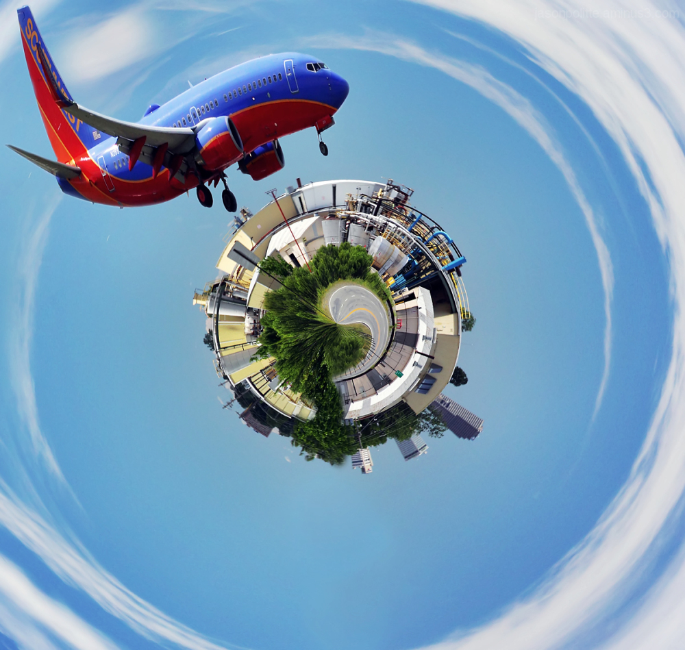 Southwest 737 with Little Rock Airport tiny planet