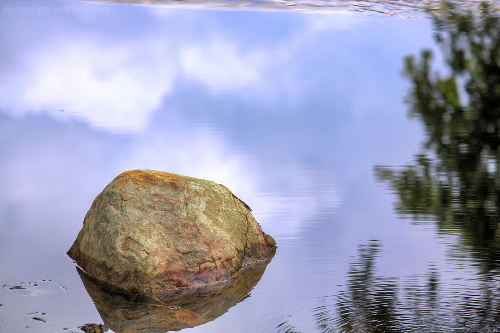 A rock amongst the ripples of water