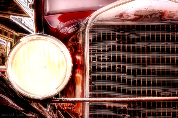 Ford Model A against the soft glow of neon lights