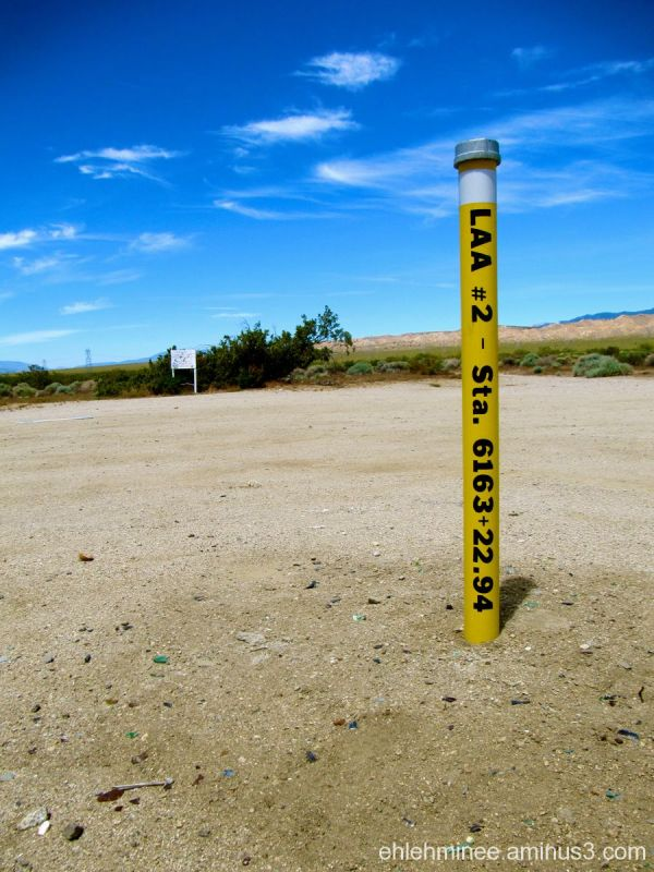 A yellow post in the Mojave desert