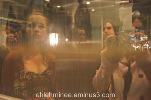 Candid reflection in elevator window