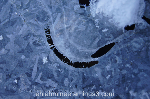 A monster face in the frozen ice