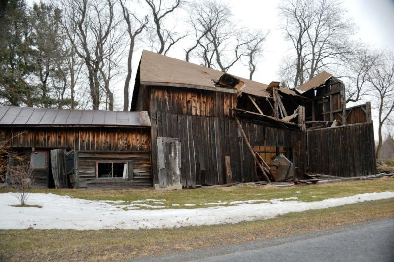 One more winter's damage for the old barn