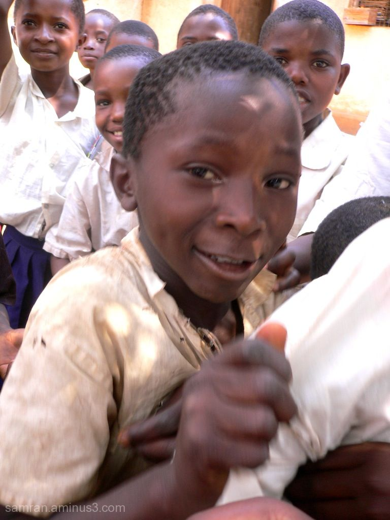 school boy, happy face, tanzania