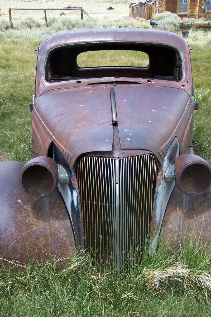 Old car in someone's backyard Bodie, CA