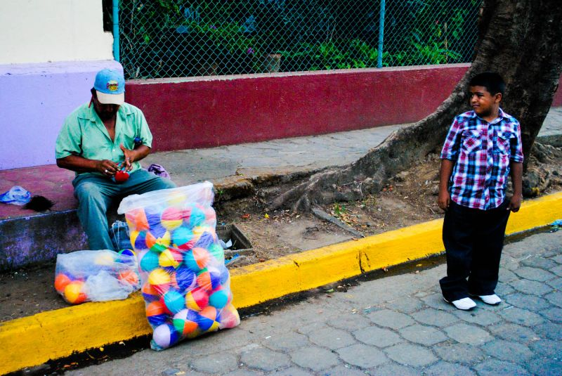 Child wanting balloons - Leon, Nicaragua