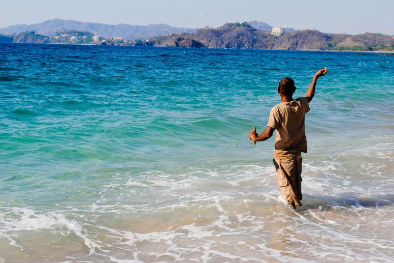Playa Conchal man fishing beach Costa Rica