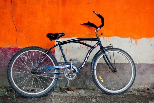 Ride bike orange wall dripping