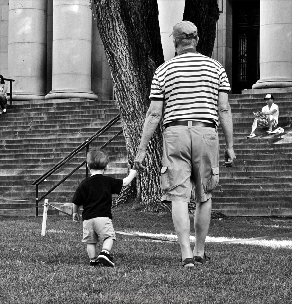 Grandfather walking with child