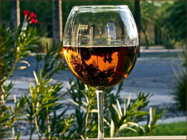 Reflection of street through wine glass