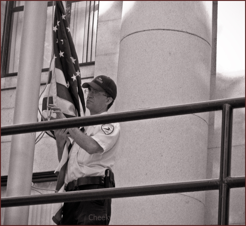 Lowering the flag at Prescott Courthouse