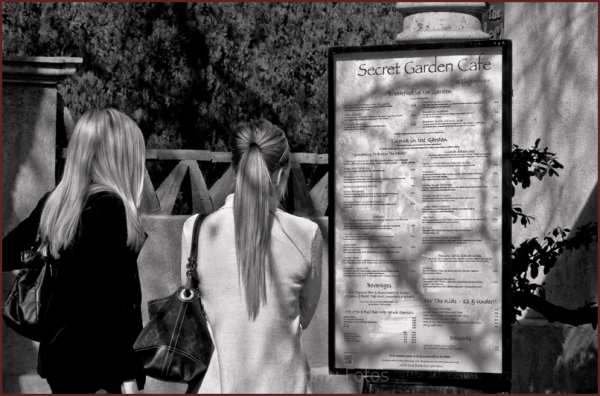 Two girls contemplate menu