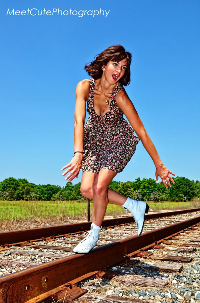 Girl falling off train tracks