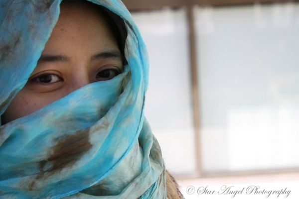 The Girl with the Turquoise Scarf