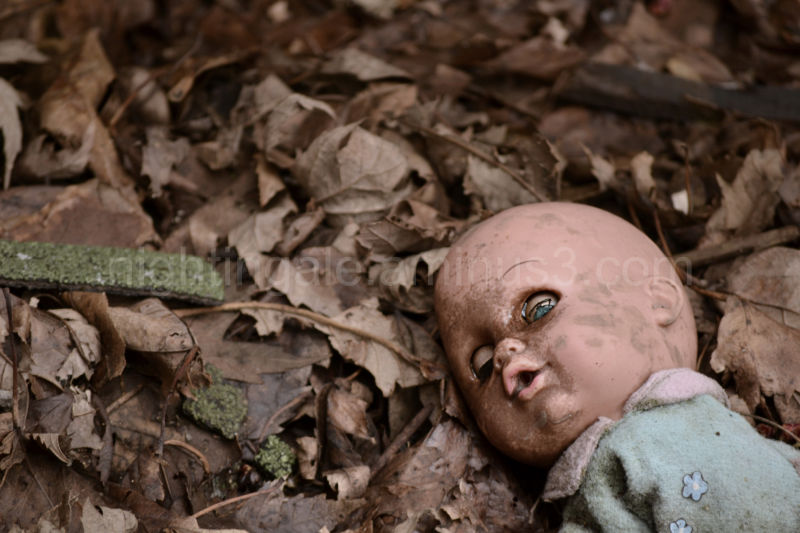 A child's doll abandoned in a decaying house