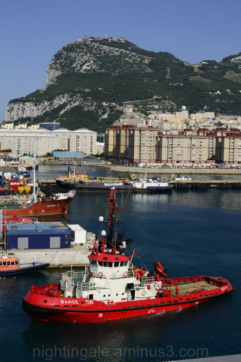 A tugboat in the shadow of the Rock of Gibraltar