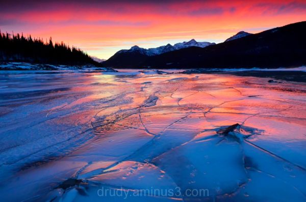 A reflected sunset on ice heaves