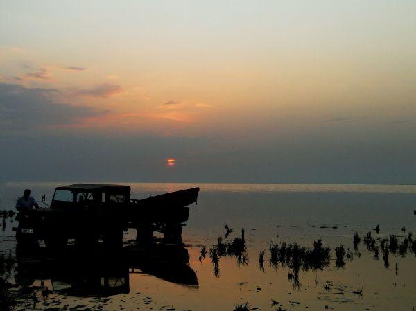 a boat carrier Jeep ruined in seaside sludge