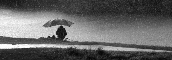 A fisherman in the rain