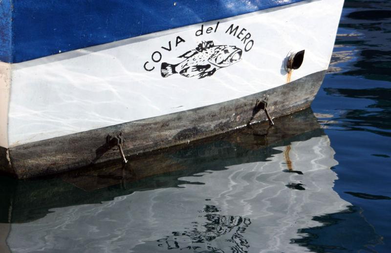 blue boat at sea