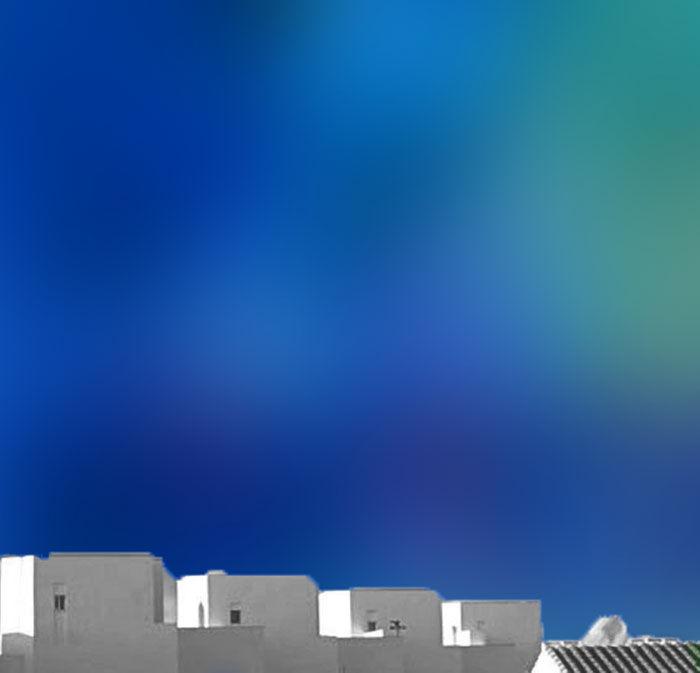 white village on coloured sky