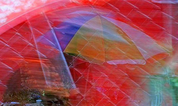 colourful umbrella under rain