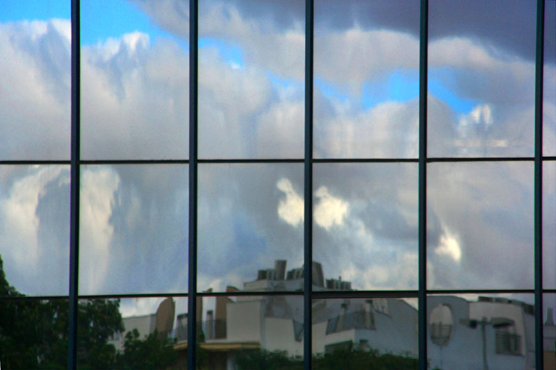clouds reflection on modern offices