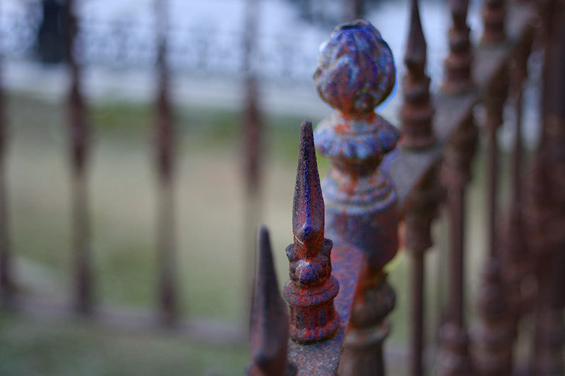 part of a rusty fence
