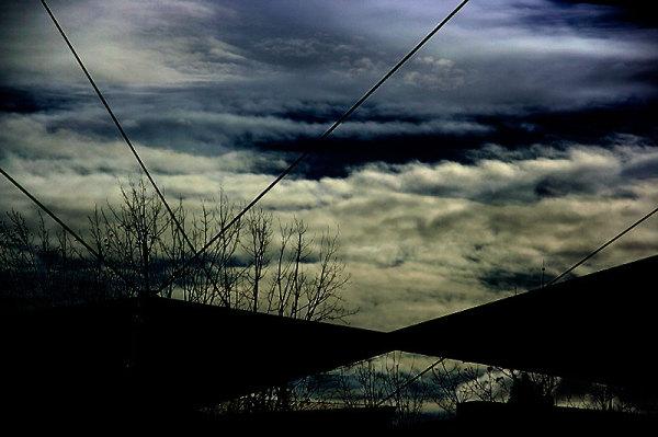 clouds lines bridge sky seville