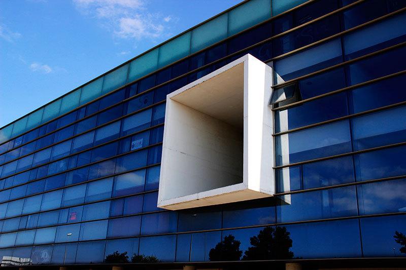 modern building glass reflection blue