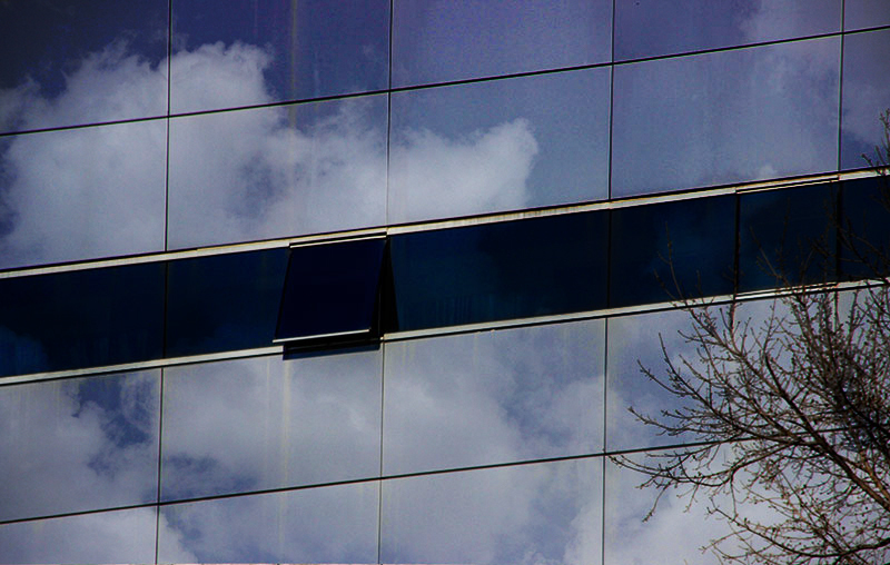 modern building glass reflections clouds