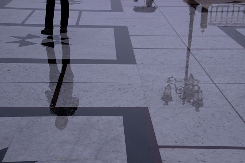 Rain reflection on marble floor