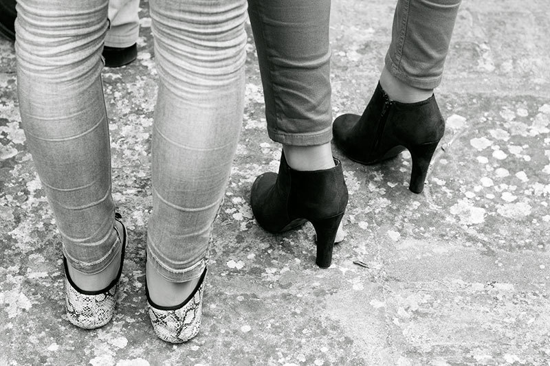 people feet and legs in black&white