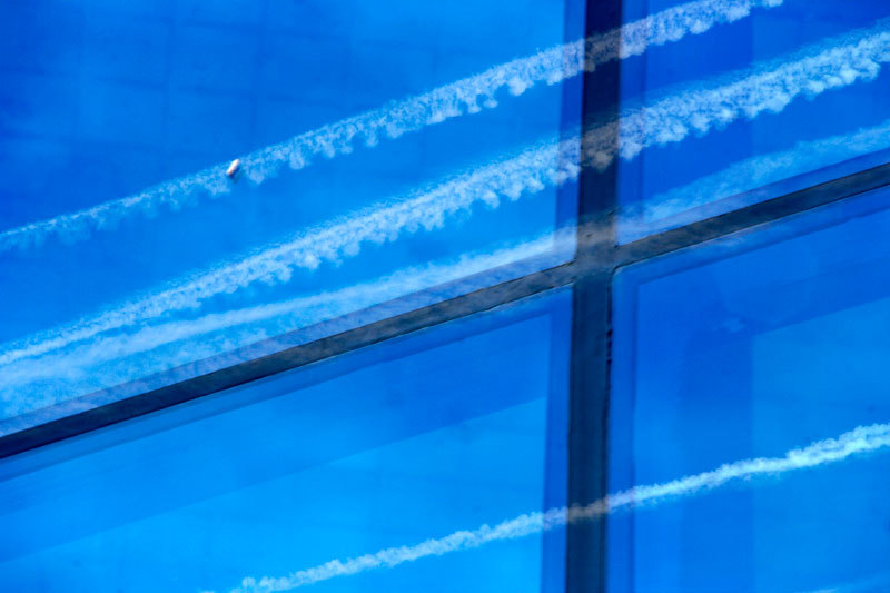 trails and blue sky reflections on windows