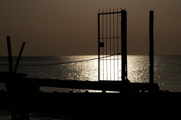 door sea sunset