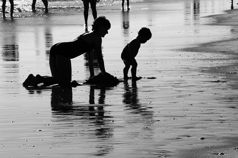 shadows of mother and son at the seaside