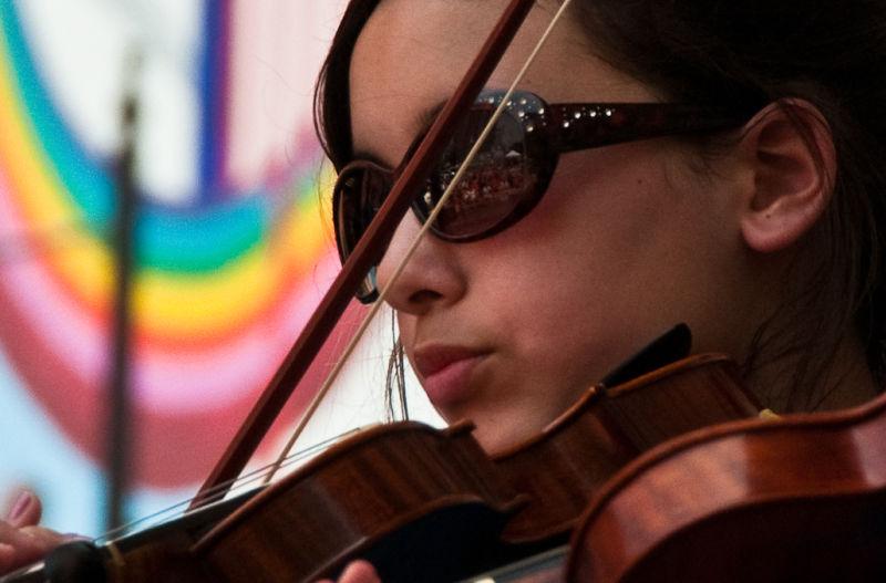 Youthful musician at an art fair.