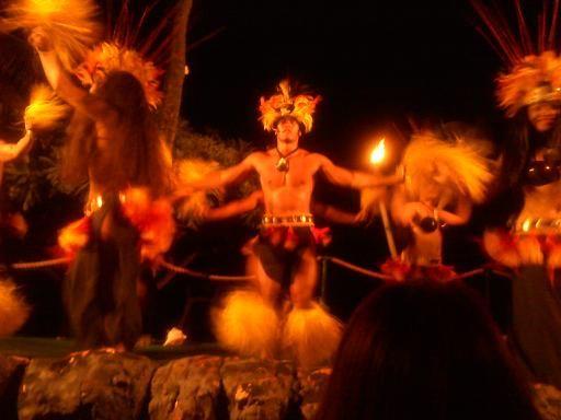 fire dancer and hula dancers in hawaii